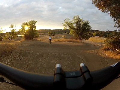© Joseph Dougherty. All rights reserved.  Mountain biking; sunset at Folsom Lake when levels are very low.