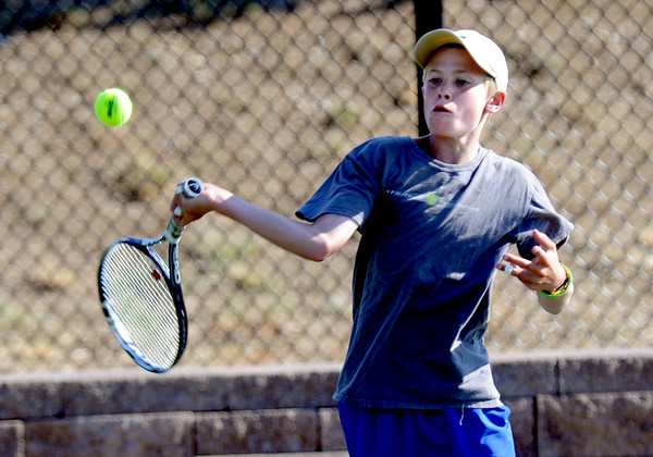 "Kap Smith competes in the finals of the 12-year-old age group on Saturday.<br /> For more photos of local players, go to  <a href=""http://www.dailycamera.com"">http://www.dailycamera.com</a>.<br /> Cliff Grassmick / June 30, 2012"