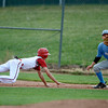 "Fairview's Ryan Madden slides to safety on first base at the bottom of the fourth inning on Friday, July 6, during a baseball game against Mountain Range at Fairview High School in Boulder. For more photos of the game go to <a href=""http://www.dailycamera.com"">http://www.dailycamera.com</a>"
