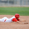 "Fairview's Cam Frazier slides to become out at the bottom of the third inning on Friday, July 6, during a baseball game against Mountain Range at Fairview High School in Boulder. For more photos of the game go to <a href=""http://www.dailycamera.com"">http://www.dailycamera.com</a>"