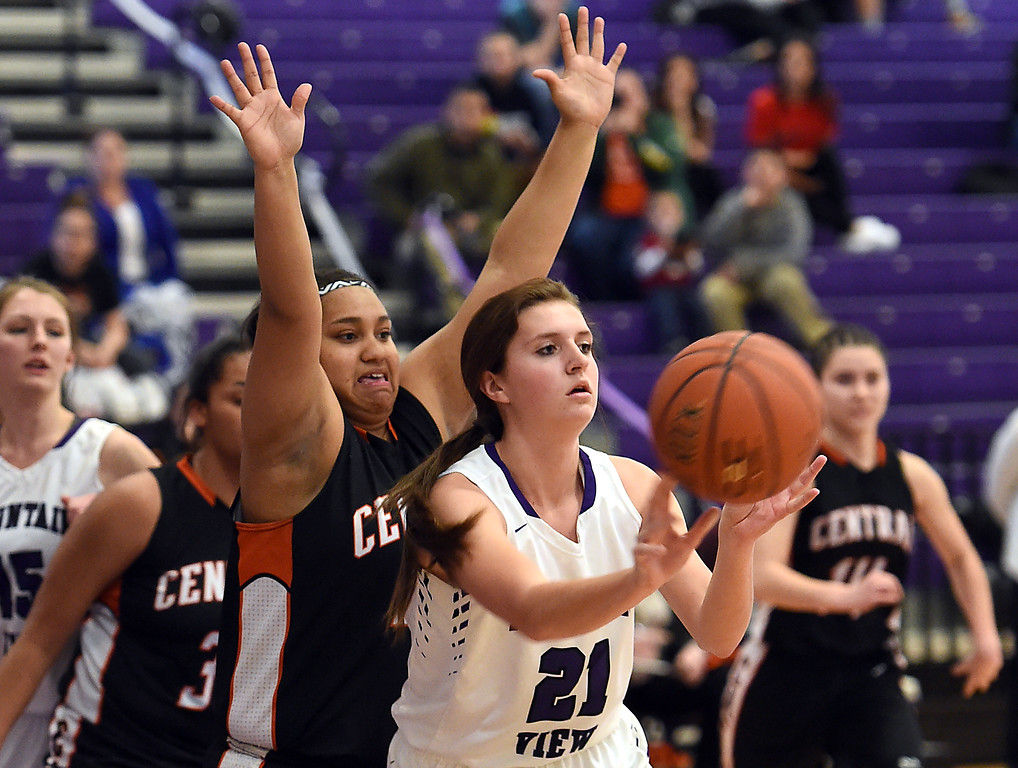 . Mountain View\'s #21 Madison Langman passes the ball as Greeley Central\'s #41 Ebony Montanez tries to block during their game Wednesday, Feb. 15, 2017, at Mountain View in Loveland.  (Photo by Jenny Sparks/Loveland Reporter-Herald)