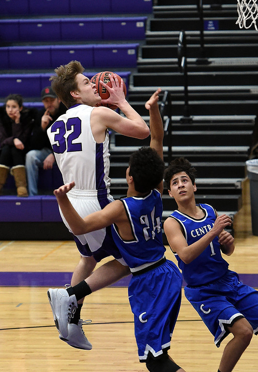. Mountain View\'s (32) Trey Bruschke goes up for a shot past Pueblo Central High\'s (24) Nico Martin during their game Wednesday, Feb. 21, 2018, at Mountain View High School in Loveland. (Photo by Jenny Sparks/Loveland Reporter-Herald)