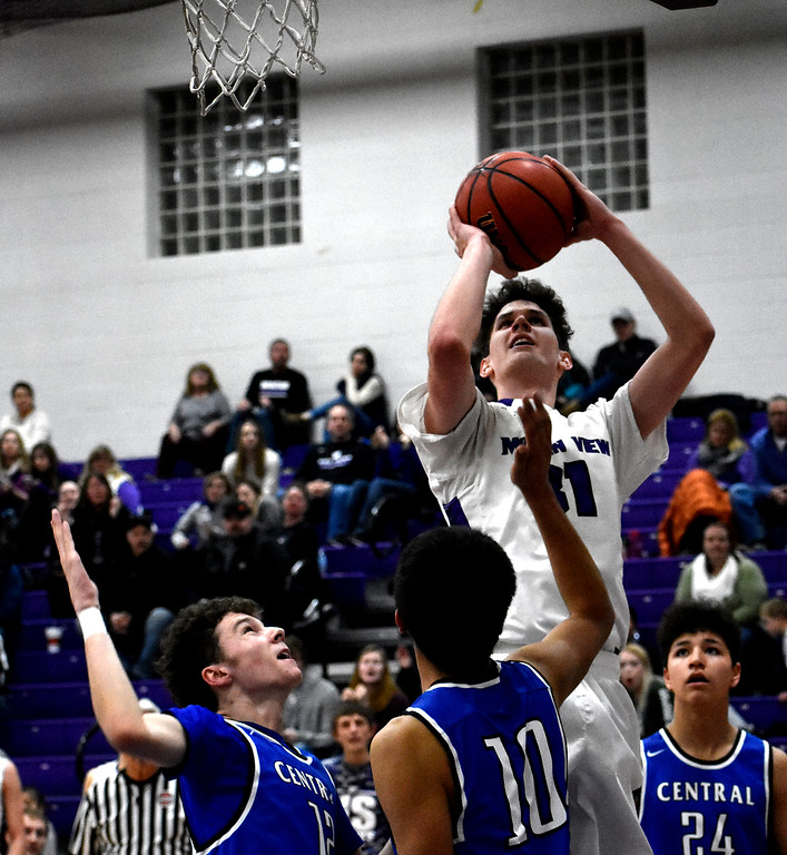 . Mountain View\'s (31) Brian Flohr has a chance to score between Pueblo\'s (12) Tyler Santry\'s and (10) Jacob Madrid\'s block during their game on Wednesday, Feb. 21, 2018, at Mountain View High School in Loveland. Photo by Thieng Mai/Loveland Reporter-Herald.