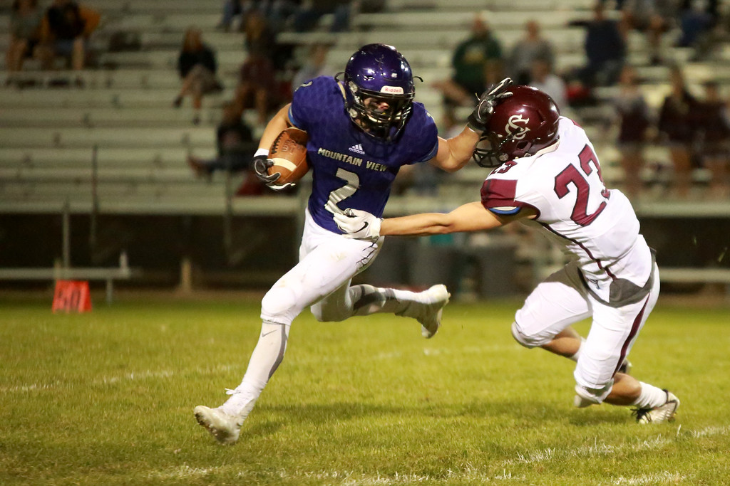 . Mountain View�s (2) Shane Rasicotries to block Silver Creek�s (23) Caleb Dupre on Friday night�s game on Sept. 21, 2018 at Patterson Stadium in Loveland. 