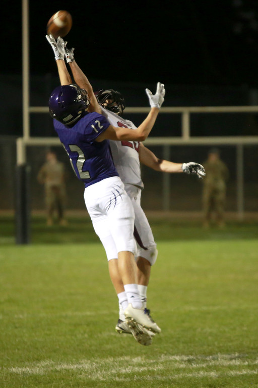 . Mountain View�s (12) Dylan Naughton reaches for the catch as Silver Creek�s (23) Caleb Dupre goes for the block on Friday night�s game on Sept. 21, 2018 at Patterson Stadium in Loveland. 