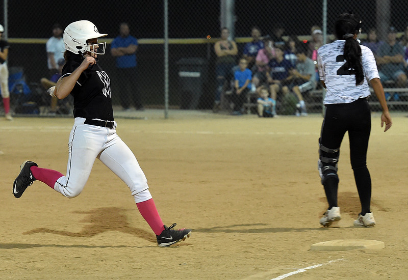 Mountain View's (9) Kelsey Basart runs to third base during their game against Thompson Valley Wednesday, Sept. 12, 2018, at Centennial Field in Loveland.  (Photo by Jenny Sparks/Loveland Reporter-Herald)