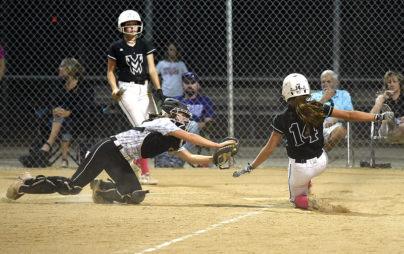 Thompson Valley's catcher (14) Autumn Porter tags Mountain View's (14) Kendall Petty out during their game Wednesday, Sept. 12, 2018, at Centennial Field in Loveland.  (Photo by Jenny Sparks/Loveland Reporter-Herald)