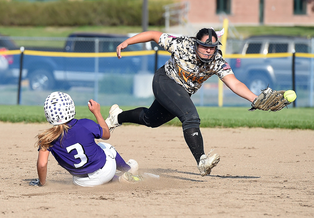 . Thompson Valley\'s (12) Cassie Orozco tries to catch the ball as Mountain View\'s (3) Jaelyn Taylor slides into second Tuesday, Sept. 26, 2017, during their game at Mountain View in Loveland.  (Photo by Jenny Sparks/Loveland Reporter-Herald)
