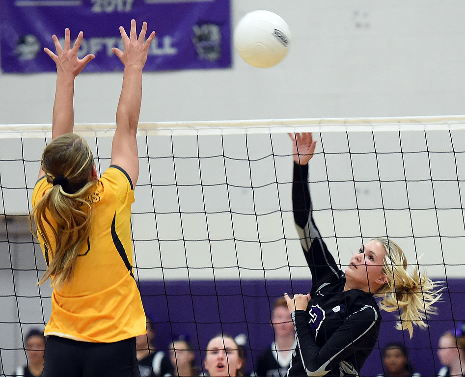 . Mountain View\'s Calli Wilson (3) spikes the ball as Thompson Valley\'s Abbie McCrimmon tries to block during their game Tuesday, Sept. 18, 2018, at Mountain View High School in Loveland.  (Photo by Jenny Sparks/Loveland Reporter-Herald)