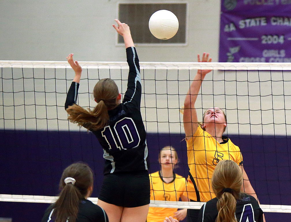 . Thompson Valley�s Abbie McCrimmon (5) and Mountain View�s Megan Hurr (10)  go head to head over the net on Sept. 18, 2018 at Mountain View High School in Loveland. Photo by Taelyn Livingston/ Loveland Reporter-Herald