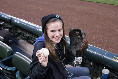 Stephanie looking pretty happy after getting the game ball from Chone Figgins