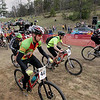 Record-Eagle/Keith King<br /> Lee Slater, foreground, along with other riders, leaves the starting line as they compete Saturday, May 7, 2011 during the Mud, Sweat and Beers mountain bike races at the Mt. Holiday Ski and Recreation Area.