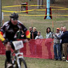 Record-Eagle/Keith King<br /> Spectators watch and cheer as a racer crosses a mud pit and makes his way toward the finish line during the Mud, Sweat and Beers mountain bike races Saturday, May 7, 2011 at the Mt. Holiday Ski and Recreation Area.