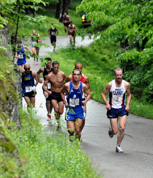 At just over 10 minutes into the 49th Mt. Washington Road Race, held June 20th, 2009, the elite runners began to separate from other competitors. Leading the pack are last year's winner Eric Blake (bib #1), and eventual race winner Rickey Gates (bib #2).