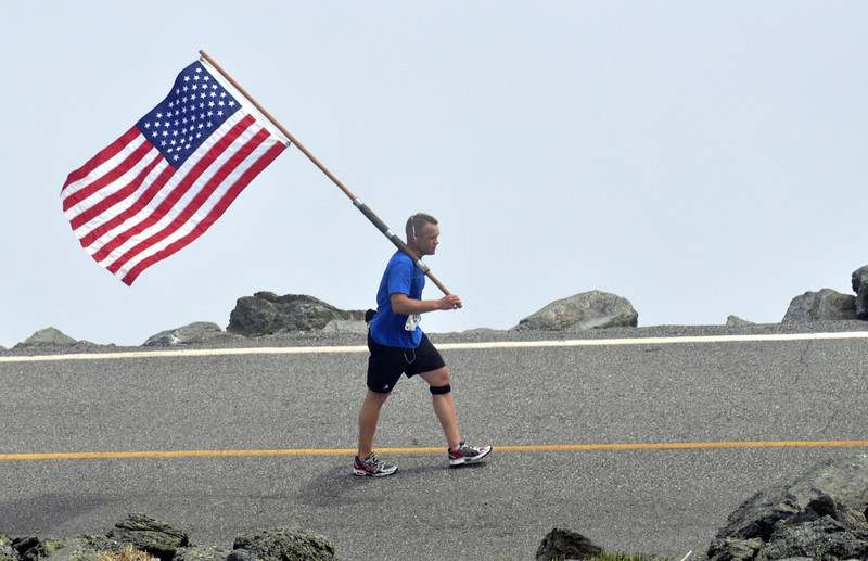 James Soucy, of Candia, NH, nearing the finish line of the 49th Mt. Washington Road Race, held June 20th, 2009. Mr Soucy finished the 7.6 mile course in 1:52:53, while proudly carrying the American Flag.