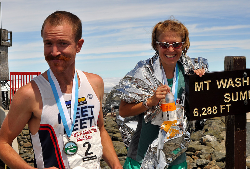 Having both just win the 49th Mt. Washington Road Race in their respective divisions, Rickey Gates and Brandy Erholtz share a light-hearted moment. Mr Gates covered the 7.3 mile up mountain course in 59:58, and Ms. Erholtz came in at 1:10:53 to win the race for the 2nd year in a row.