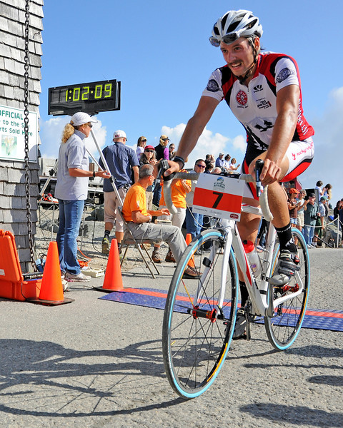 Pete Ostroski, of Intervale, NH, crosses the finish line at The 39th Annual Mt. Washington Auto Road Bicycle Hillclimb, which was held on August 20st, 2011, in Gorham, New Hampshire. Cyclists raced up the grueling 7.6 mile Auto Road course, to the 6,288' summit of Mt. Washington, the highest peak in the Northeastern United States. The 22 year old Ostroski finished in 8th place, with an official time of 1:02:09.