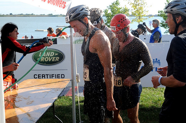 """The Muddy Buddy  finishers were washed off at no extra charge.<br /> The Muddy Buddy Ride and Run requires a 2-person team to finish a 6-7 mile course with 5 obstacles. One member will ride and one will run, but they need to finish together. The race was held at the Boulder Reservoir on Sunday.<br />  For more photos and a video, go to  <a href=""""http://www.dailycamera.com"""">http://www.dailycamera.com</a>.<br /> <br /> <br /> Cliff Grassmick / August 16, 2009"""