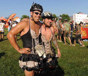 Mike Davis, left,  and Nathan Brailsford were the best costume winners of the Muddy Buddy. The Muddy Buddy Ride and Run requires a 2-person team to finish a 6-7 mile course with 5 obstacles. One member will ride and one will run, but they need to finish together. The race was held at the Boulder Reservoir on Sunday.  For more photos and a video, go to www.dailycamera.com.   Cliff Grassmick / August 16, 2009
