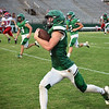 Matt Hamilton/Daily Citizen-News<br /> MC5 tears down the field on the way to a TD.