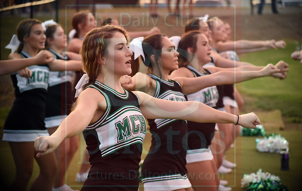Matt Hamilton/Daily Citizen-News<br /> MC cheerleader Emily Sanford, 16, cheers on the Indians with the cheerleading team on Friday.