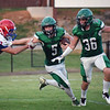 Matt Hamilton/Daily Citizen-News<br /> MC5 breaks a tackle on his way to a TD.