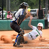 Matt Hamilton/Daily Citizen-News<br /> MC6 slides in safe at home as the Armuchee catcher can't control the ball to apply the tag in time.