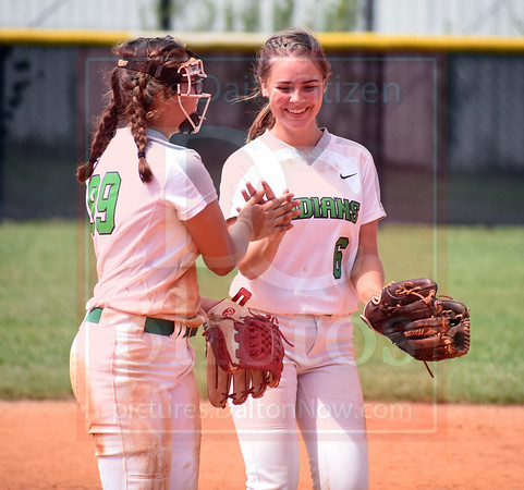 Matt Hamilton/Daily Citizen-News<br /> MC99 and MC6 celebrate after MC99 made a throw from third to first for an out.
