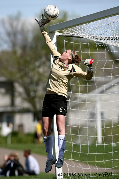 """Fingertip Save""<br /> <br /> This goalie tipped this save at the peak of her jump.  This photo was taken during the semi-finals of the U16 Girls Minnesota State Cup Tournament (May 2008); it was a nice sunny day."