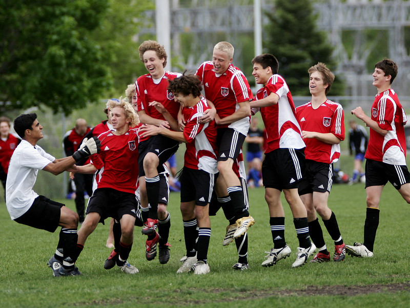 """Jubilation""<br /> <br /> The U16 boys (2006) from Eden Prairie Soccer Club celebrate their shootout victory over Valley United to advance to the finals of the Minnesota State Cup.  Taken in cloudy conditions (May 2006)."