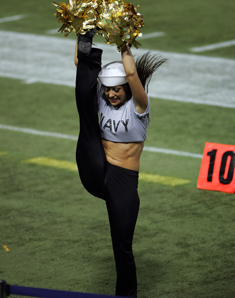 """Flexibility""<br /> <br /> Cheerleader Chelsie with a uniform honoring the U.S. Armed Serves taken during a Minnesota Vikings game inside the Metrodome (Minneapolis, MN).<br /> <br /> (DISCLAIMER: THIS PHOTO IS NOT FOR SALE.   The name ""Minnesota Vikings"", the Vikings logo, the Vikings cheerleaders, MVC, and all uniform designs are official trademarks of the Minnesota Vikings organization and, the NFL, or the Metrodome.  The NFL Shield is a trademark of the National Football League. This is an unofficial site and claims no rights to these trademarks.  This site is for informational and entertainment purposes only. These photos are available for personal, non-commercial use only.  Reproduction or sale,  unless otherwise noted, is strictlly prohibited.)"