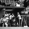 Rich Grosko (L seated) KC Kansan photographer covers a KC Royals game from the dugout, 1970's. Neil Leifer, Sports Illustrated uses a 2000mm lens (R).