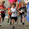 "Participants in the Kids 2K run sprint out of the start gate on Sunday, July 10, during the North Boulder Park Classic in Boulder. For more photos and a video of the event go to  <a href=""http://www.dailycamera.com"">http://www.dailycamera.com</a><br /> Jeremy Papasso/ Camera"