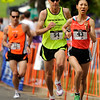 "The Women's Elite 5K winner Kaho Tanaka, front, sprints towards the finish line on Sunday, July 10, during the North Boulder Park Classic in Boulder. For more photos and a video of the event go to  <a href=""http://www.dailycamera.com"">http://www.dailycamera.com</a><br /> Jeremy Papasso/ Camera"
