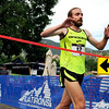 "The Men's Elite 5K winner Justin Gindlesperger crosses the finish line on Sunday, July 10, during the North Boulder Park Classic in Boulder. For more photos and a video of the event go to  <a href=""http://www.dailycamera.com"">http://www.dailycamera.com</a><br /> Jeremy Papasso/ Camera"