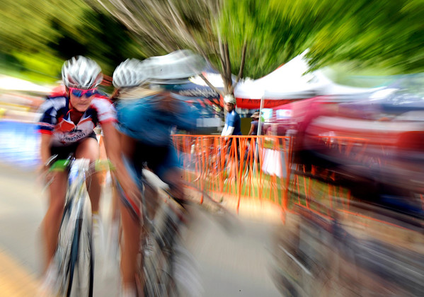 "Ryan Sotebeer, 14, of Parker, left, speeds up a hill while racing in the Senior Women's Cat. 4 race on Sunday, July 10, during the North Boulder Park Classic in Boulder. For more photos and a video of the event go to  <a href=""http://www.dailycamera.com"">http://www.dailycamera.com</a><br /> Jeremy Papasso/ Camera"