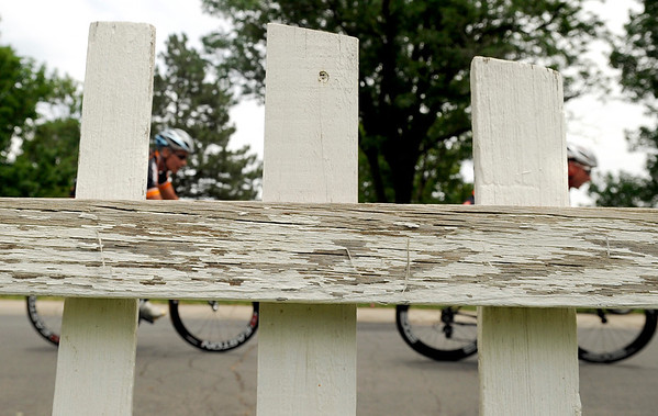 "Racers in the Master Men's 35+ group ride past a picket fence on Sunday, July 10, during the North Boulder Park Classic in Boulder. For more photos and a video of the event go to  <a href=""http://www.dailycamera.com"">http://www.dailycamera.com</a><br /> Jeremy Papasso/ Camera"