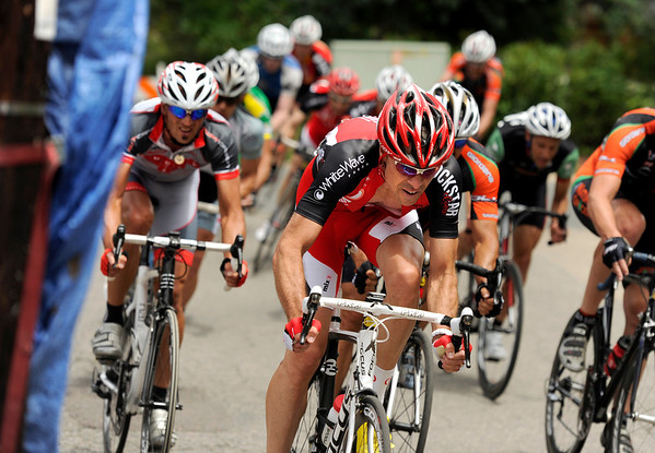 """Racers in the Master Men's 35+ group round a corner on Sunday, July 10, during the North Boulder Park Classic in Boulder. For more photos and a video of the event go to  <a href=""""http://www.dailycamera.com"""">http://www.dailycamera.com</a><br /> Jeremy Papasso/ Camera"""