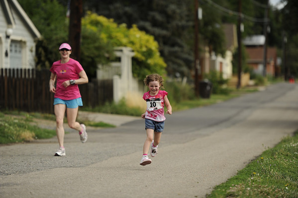 "Fiorella Freis, 4, sprints down the back leg of the course with her mother Jeannie following her for support on Sunday, July 10, during the North Boulder Park Classic in Boulder. For more photos and a video of the event go to  <a href=""http://www.dailycamera.com"">http://www.dailycamera.com</a><br /> Jeremy Papasso/ Camera"