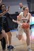 #11 Keller guard Renee Chmiel breaks through the lane to the basket.