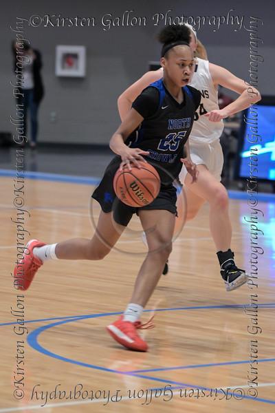 #25 N. Crowley forward Maiyah Watkins drives the lane towards the basket.