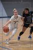 #2 Keller guard Cambridge Mathews drives the lane to the basket past #11 N. Crowley guard Kyara Reynoso.