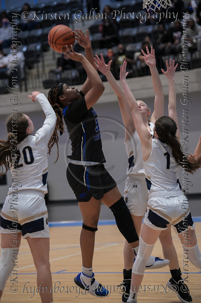 #32 N.Crowley forward Amiya Hopkins gets a shot off amongst a crowd of defenders from Keller High.