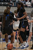 #13 Jade Goynes gets a helping hand from teammate #32 Amiya Hopkins after a collision with a Keller player.