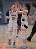 #15 Keller guard Kim Cohen and #1 guard Sarah Graves high five after Cohen draws a foul to shoot for two.