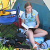 Bretta catches up on homework back at the campsite.