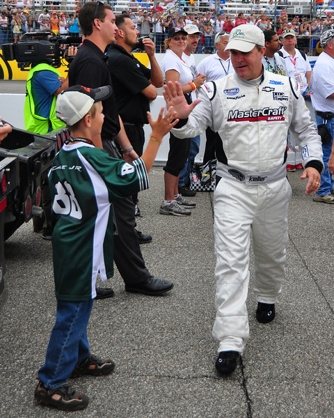 The NASCAR Nationwide Series came to New Hampshire Motor Speedway in Loudon, NH, with the New England 200, on June 26th, 2010. Driver Jason Keller gets a high-five from a fan, during driver introductions.