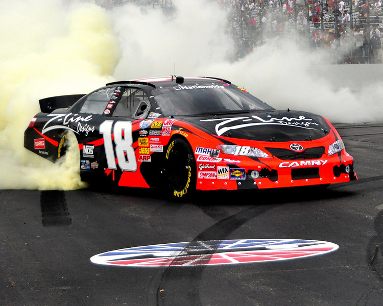 The NASCAR Nationwide Series came to New Hampshire Motor Speedway in Loudon, NH, with the New England 200, on June 26th, 2010, Kyle Busch, driving the #18 Z-Line/Joe Gibbs Toyota, celebrates after taking the checkered flag.