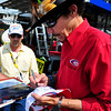 Richard Petty, former NASCAR driver of the iconic #43 STP car, signs an autograph for a fan, at New Hampshire Motor Speedway, in Loudon, NH, on Saturday, June 26th, 2010.