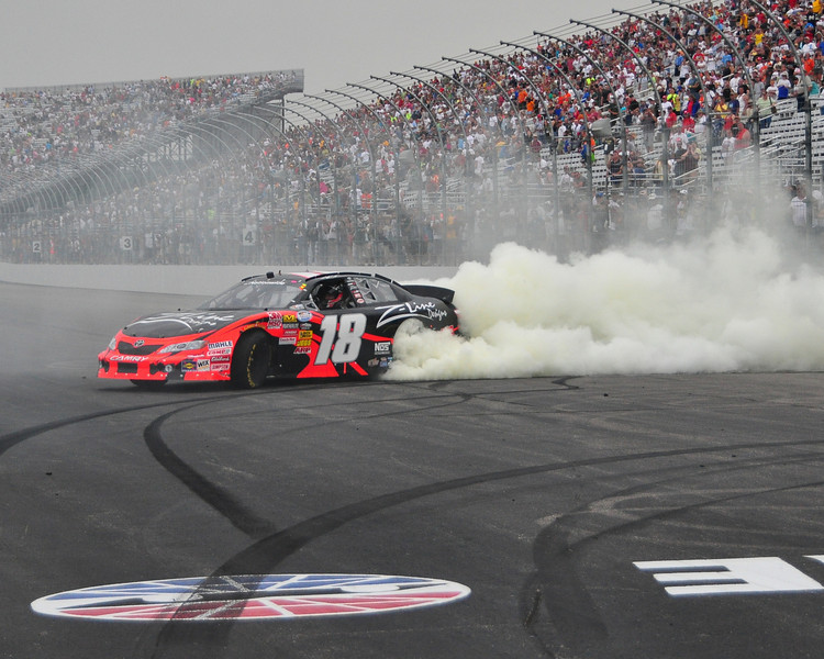 The NASCAR Nationwide Series came to New Hampshire Motor Speedway in Loudon, NH, with the New England 200, on June 26th, 2010. After winning the race, Kyle Busch celebrates by burning his tires.